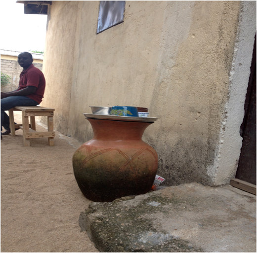 Canari in a household's compound being used for drinking water storage.